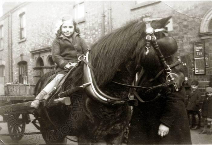 Jean Surridge  hitches a ride in 1937